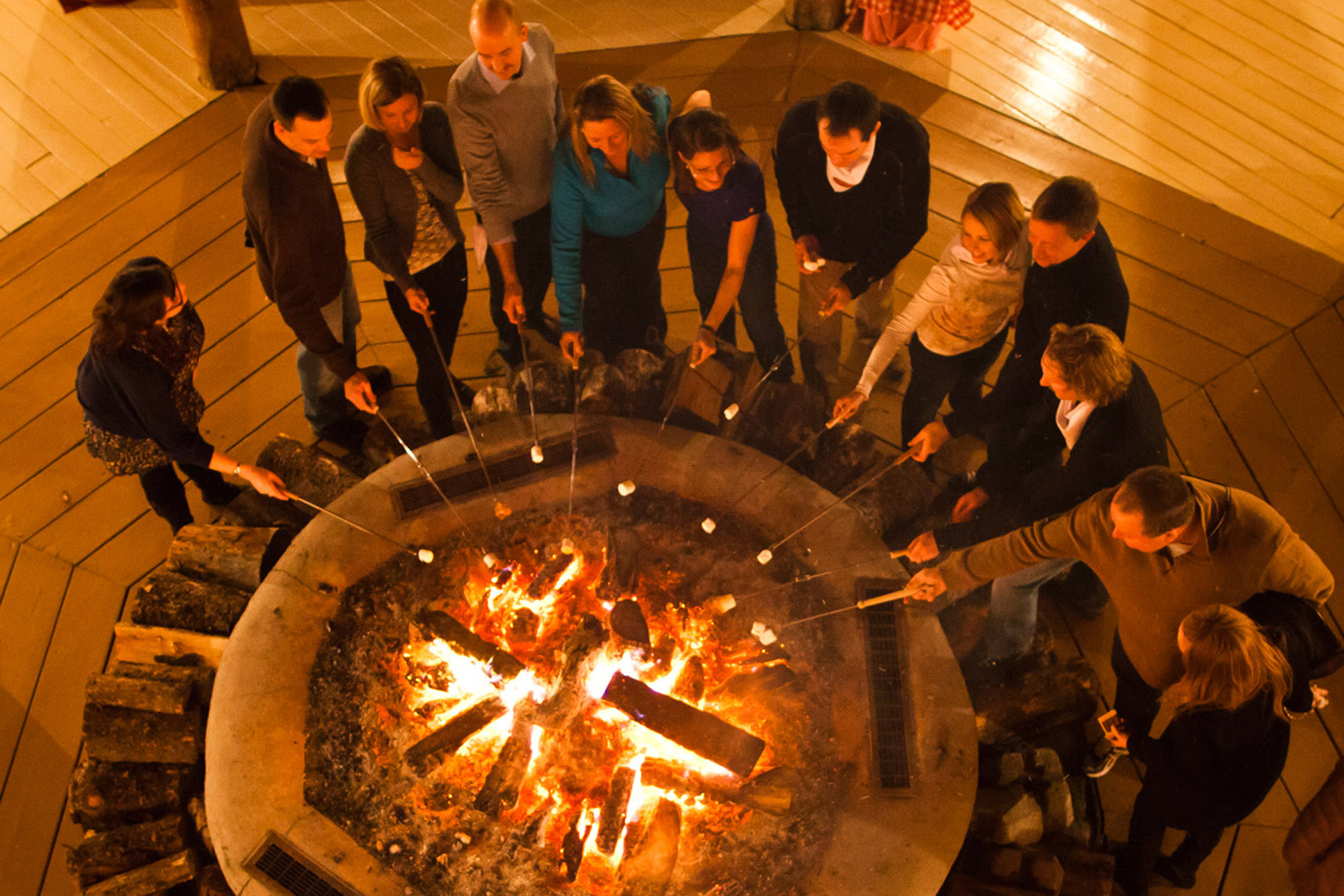 A group roasts marshmellows in Banff, AB