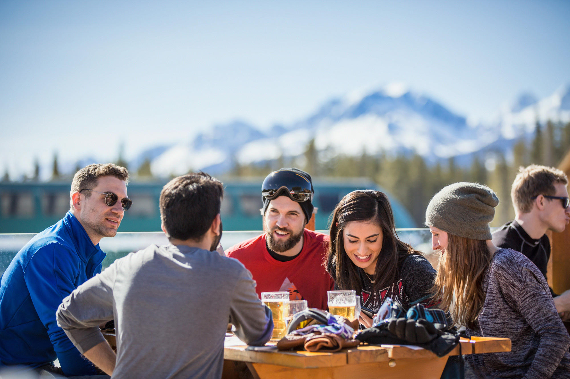 A group of friends enjoys some post-ski apres in Lake Louise, AB