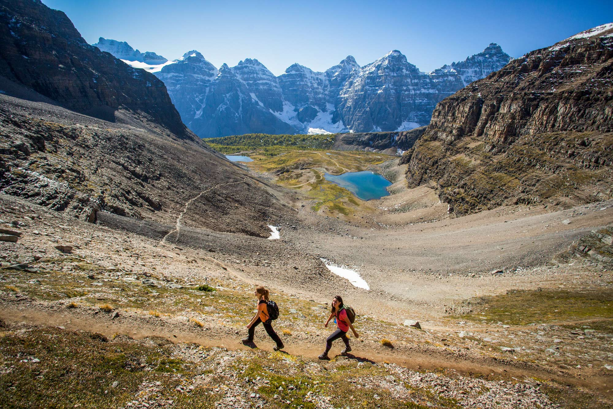 Hikers explore the stunning Sentinel Pass outside of Moraine Lake, AB.