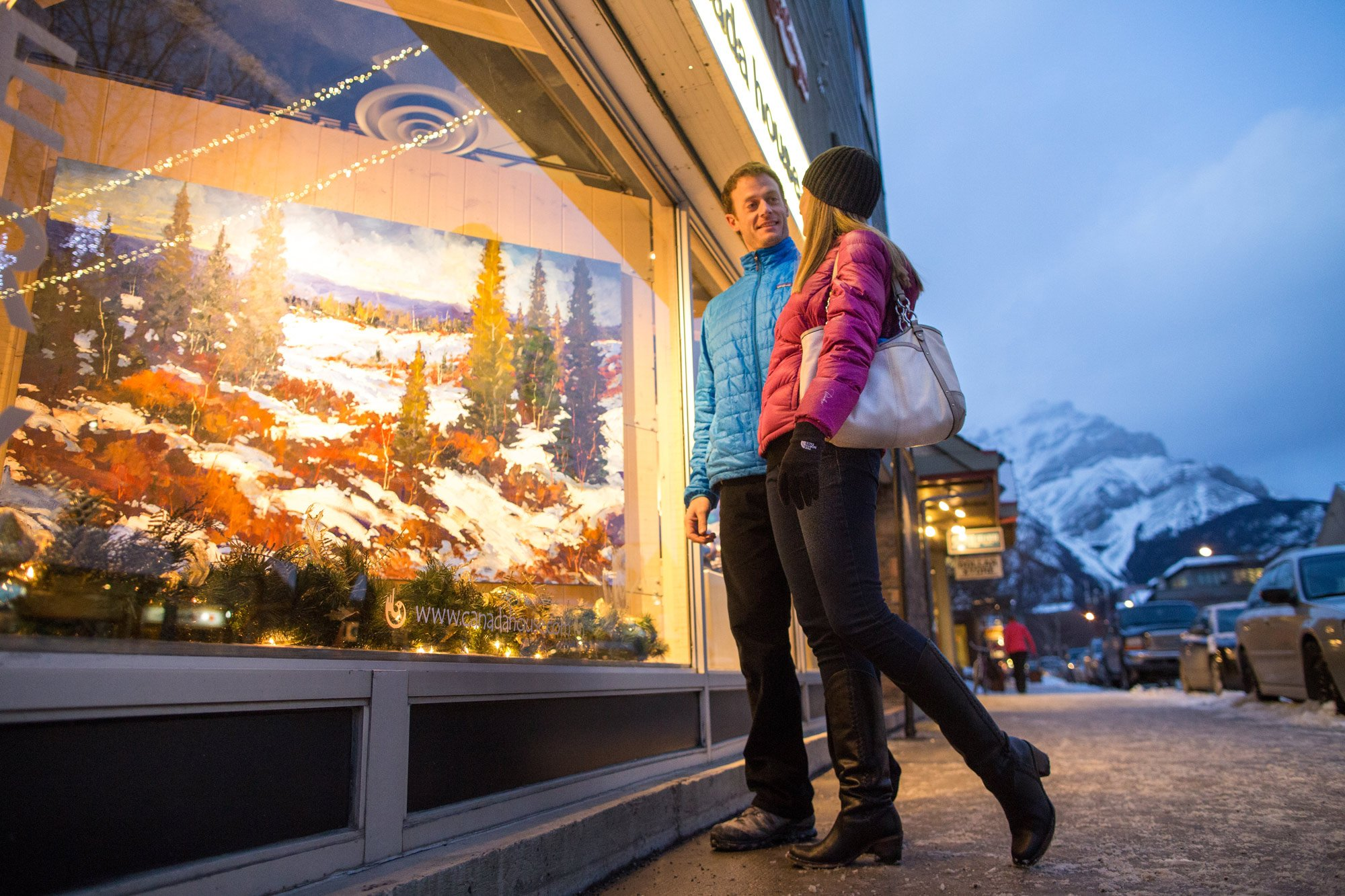 A couple wanders the streets as they in Banff and Lake Louise, AB