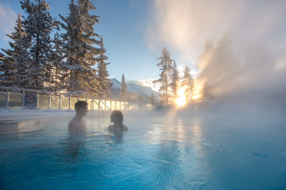 A couple enjoying the warmth of Banff Springs