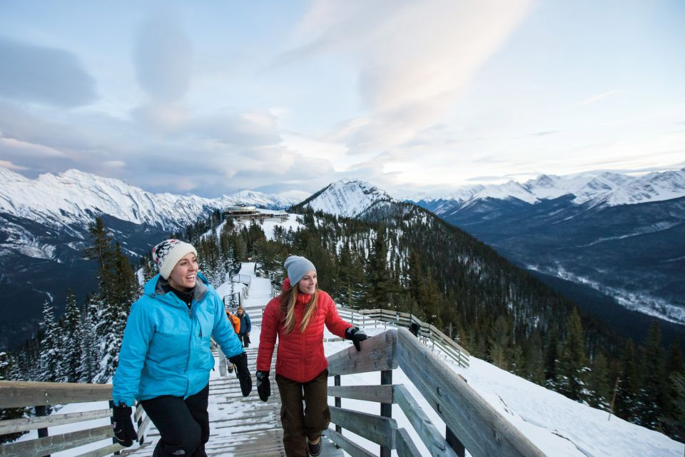 Walking along the snowy ridgelines of Sulphur Mountain, Banff National Park, AB